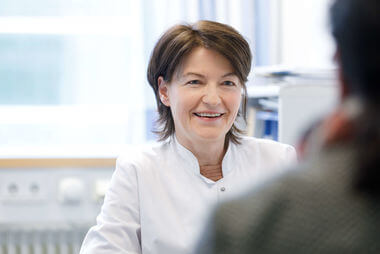 Hematology Heidelberg smiling doctor in consultation