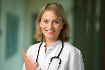 Female doctor with stethoscope smiling
