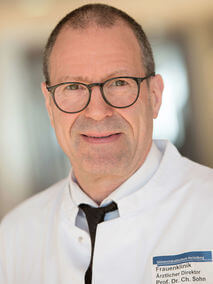 [Translate to English:] Portrait von Prof. Dr. med. Prof. h. c. Christof Sohn